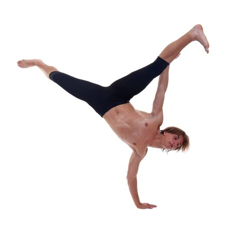 male ballet dancer: young beautiful modern ballet dancer posing - standing in one hand