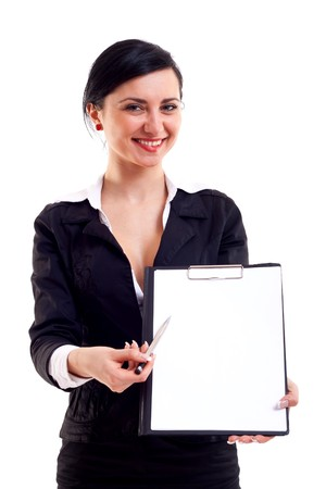 Cheerful beautiful business woman shows a blank clipboard over white background.  Stock Photo - 7564682