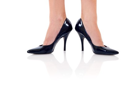 Legs with black high heels. Isolated on white background. Stock Photo - 7574362