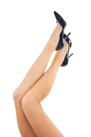 long woman legs in high heels isolated on white  Stock Photo - 7574364