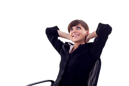 Satisfied business woman with hands crossed behind her head with look of success  Stock Photo - 7574512