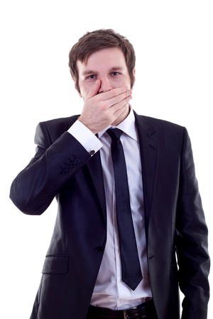 talk to the hand: business man making the speak no evil gesture over white