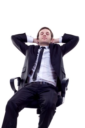 power nap: Business man having a quick sleep leaning back in his chair