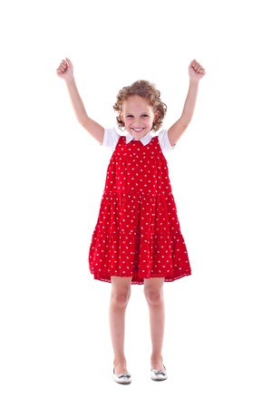 cute girl with arms raised as if in victory  Stock Photo