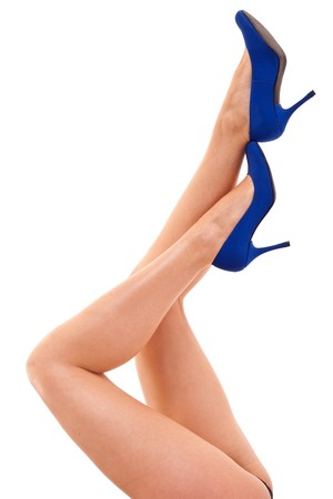 Legs with high heels isolated against a white background  photo