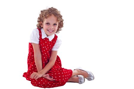 picture of a seated little girl, on white background photo