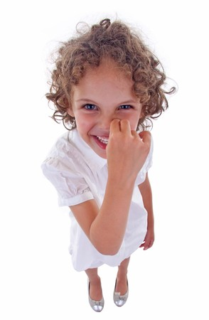 nose picking: cute little girl picking her nose over white - wide angle picture