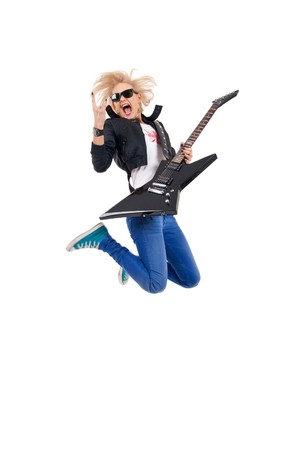 passionate woman guitarist jumps in the air over white Stock Photo - 7735435