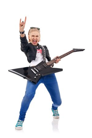 picture of an energic blond girl wearing glasses on her head and playing a guitar  Stock Photo - 7735545