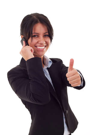 Business woman talking by cell phone and making OK sign Stock Photo - 7735835