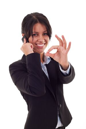 Happy business woman with phone and ok gesture, isolated  Stock Photo - 7735842