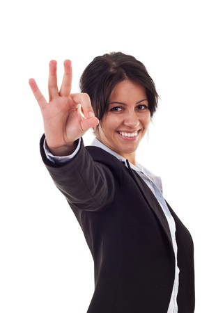 allright: Attractive business woman satisfied with results - ok sign