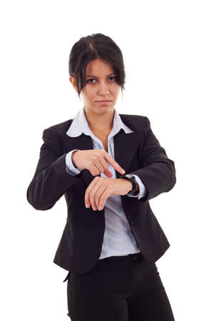 angry business woman pointing her watch over white  photo