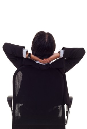 Satisfied business woman with hands crossed behind her head - rear image Stock Photo - 7735822