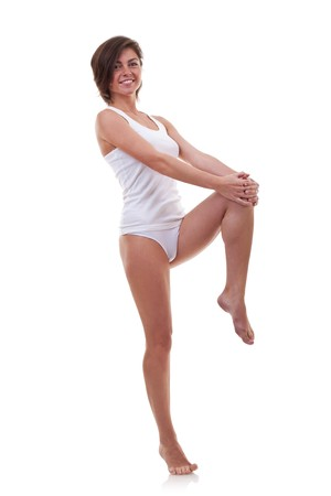 undershirt: picture of a happy woman standing on a white background in an undershirt