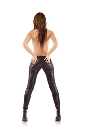 beautiful woman wearing leather pants standing with her back to the camera  Stock Photo - 7870197