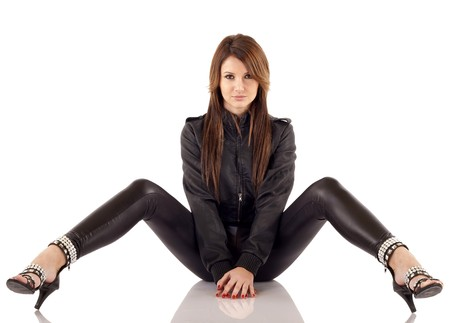 picture of a woman wearing leather outfit, seated over white  photo