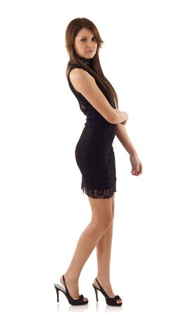 slinky: Young pretty woman in black dress. Isolated on white
