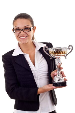 Portrait of an attractive young business woman winning a trophy against white background  Stock Photo - 7870463