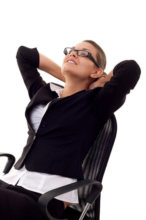 A business woman leaning back in a black chair dreaming  Stock Photo - 7870460