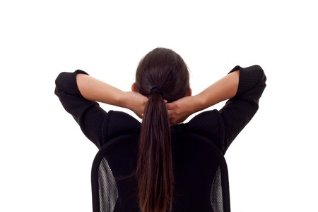 Satisfied business woman with hands crossed behind her head Stock Photo - 7870340