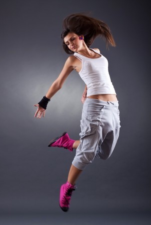 modern dancer poses in front of the white background  photo