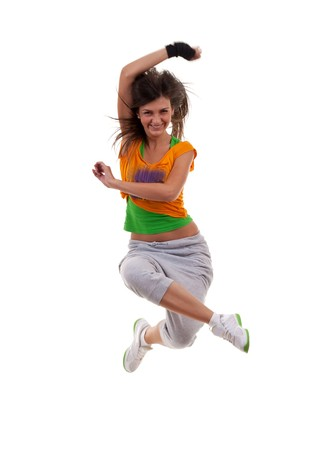 Studio isolated. Dancing woman with brown long hair and happy smiling facial expression jumping up.  photo