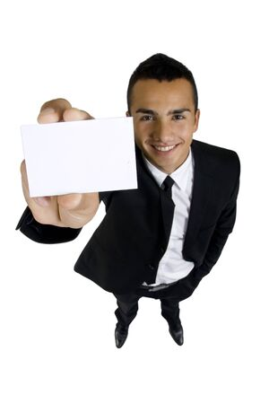 Business card in the hand of smiling business man over white photo