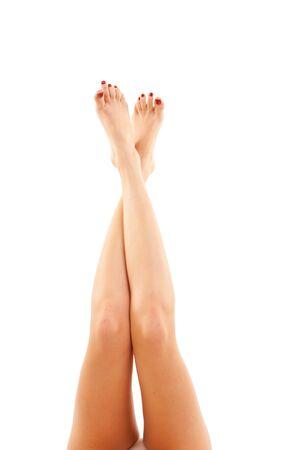 waxed: Piernas de la mujer durante mucho tiempo bastante aisladas en blanco