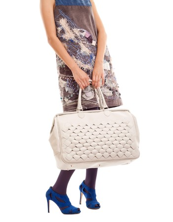 cut out image of a Young woman hoding big  purse over white photo