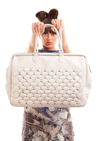 big purse is being presented by an attractive young woman photo