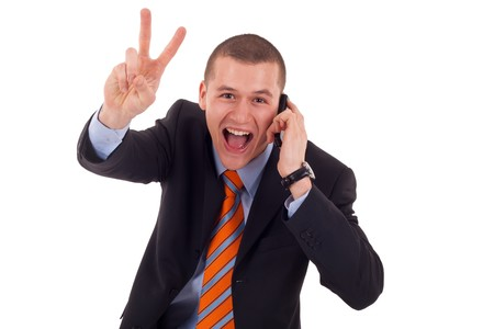 picture of a business man making victory sign while talking on the phone  photo