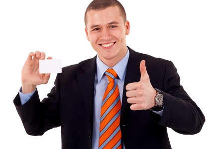 Business man giving thumbs up for the card he is holding photo