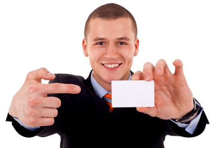 young attractive businessman shows his business card, focus is on card, face is blurred, white empty copy space, studio shoot isolated on white  photo