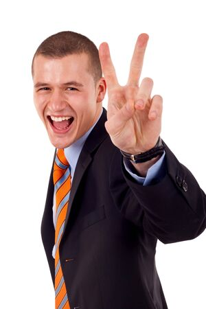 Very happy successful gesturing victory business man, isolated on white  photo
