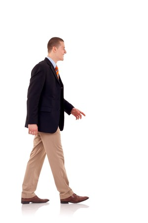 picture of a young business man walking forward - side view Stock Photo - 7939005