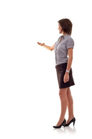 Confident business woman presenting something isolated over a white background, a lot of copyspace photo