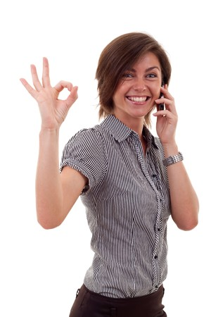 Happy business woman with phone and ok gesture, isolated  photo