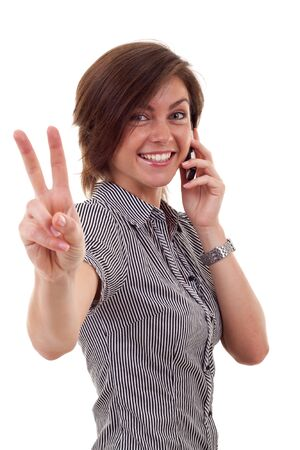 Happy business woman with phone and victory gesture, isolated  photo