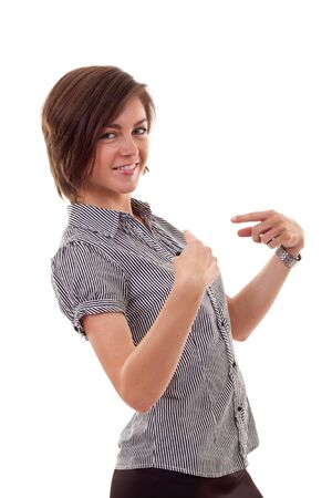 femme brune: A young beautiful business woman pointing at her