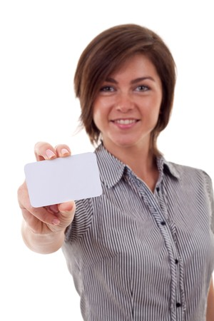 Portrait of a beautiful business woman holding a white card. Isolated  photo
