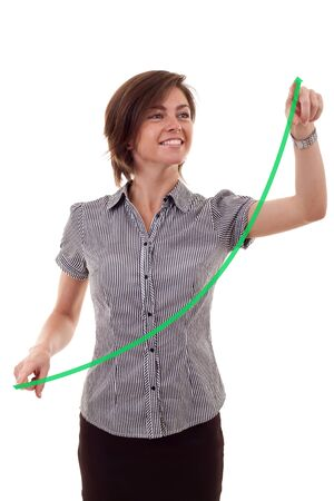 business woman drawing a growing graph over white  photo