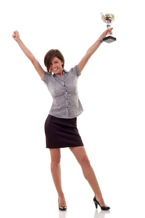 Portrait of an excited young business woman winning a trophy against white background  Stock Photo - 7939049