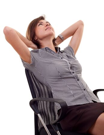 Smiling business woman leaning back on a chair over white photo
