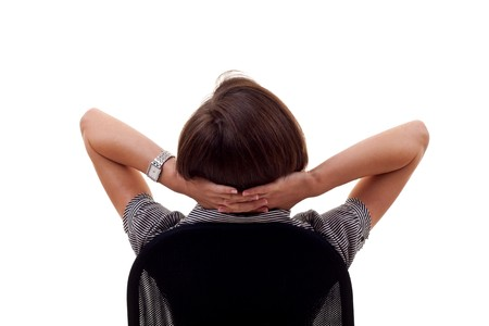Satisfied business woman with hands crossed behind her head  Stock Photo - 7939080