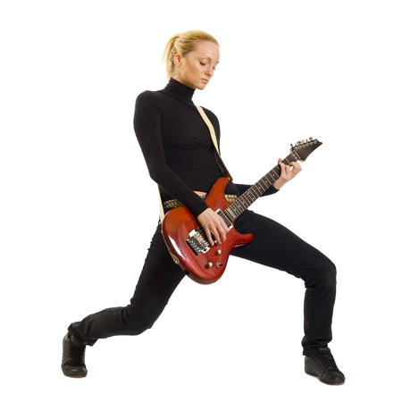 he beautiful blonde with a guitar over white background photo