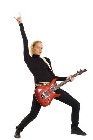 passionate woman guitarist playing the guitar and making a rock sign  photo