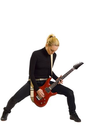 Smiling girl playing electric guitar over white backgound photo