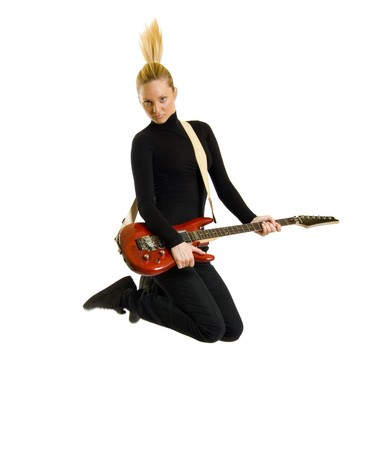 headbanging woman guitarist jumps over white background  photo