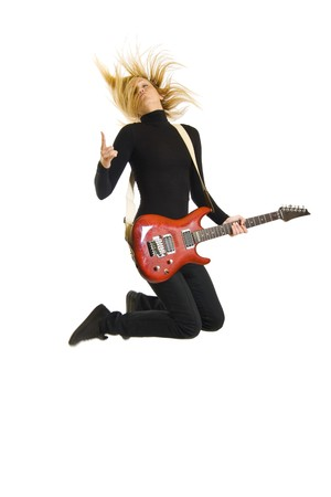 passionate woman guitarist jumps in the air over white photo